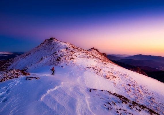 Mountain view at dusk, banner image, Skiing, Elaine's Travel